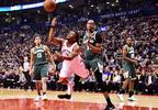 Toronto Raptors guard Kyle Lowry (7) throws up a shot as he is fouled by Milwaukee Bucks forward John Henson (31) during first half NBA basketball action in Toronto on Monday, Jan. 1, 2018.