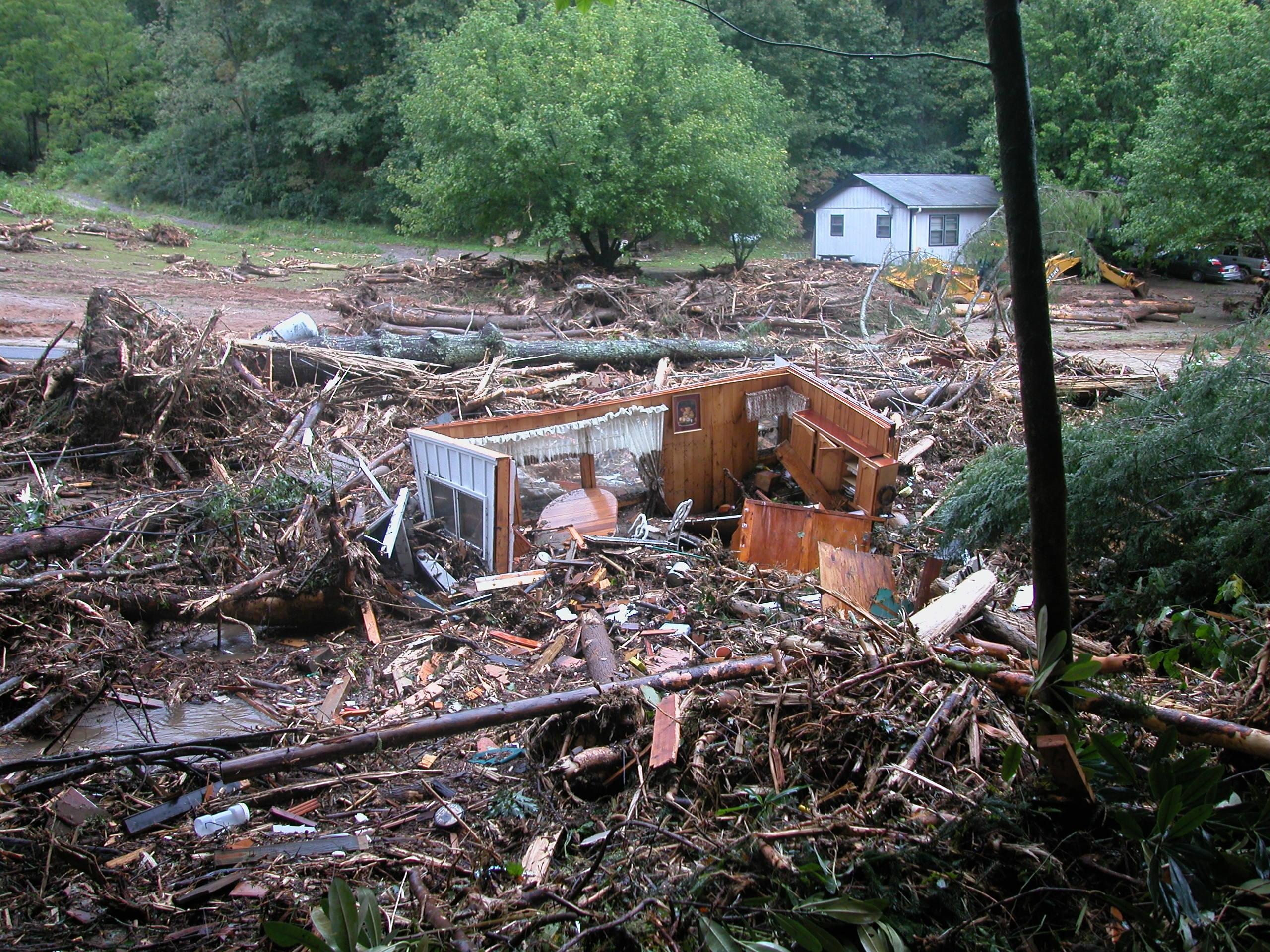 Polk County is dealing with immediate needs after its recent mudslide. Some 14 years ago, it was Macon County residents who were dealing with a devastating mudslide. Lessons learned then could prove helpful now, including how long recovery takes. (Photo credit: Macon Co. Emergency Services)