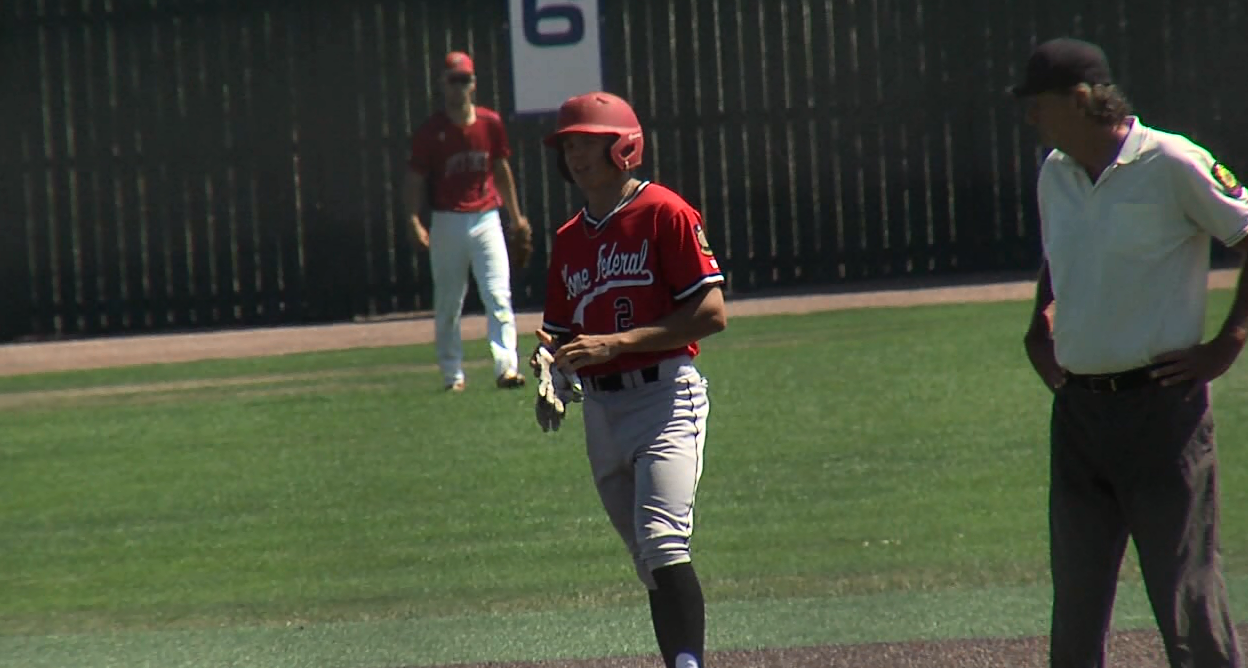 Grand Island's Shay Schanaman stands on 2nd base after hitting a double. (NTV News)
