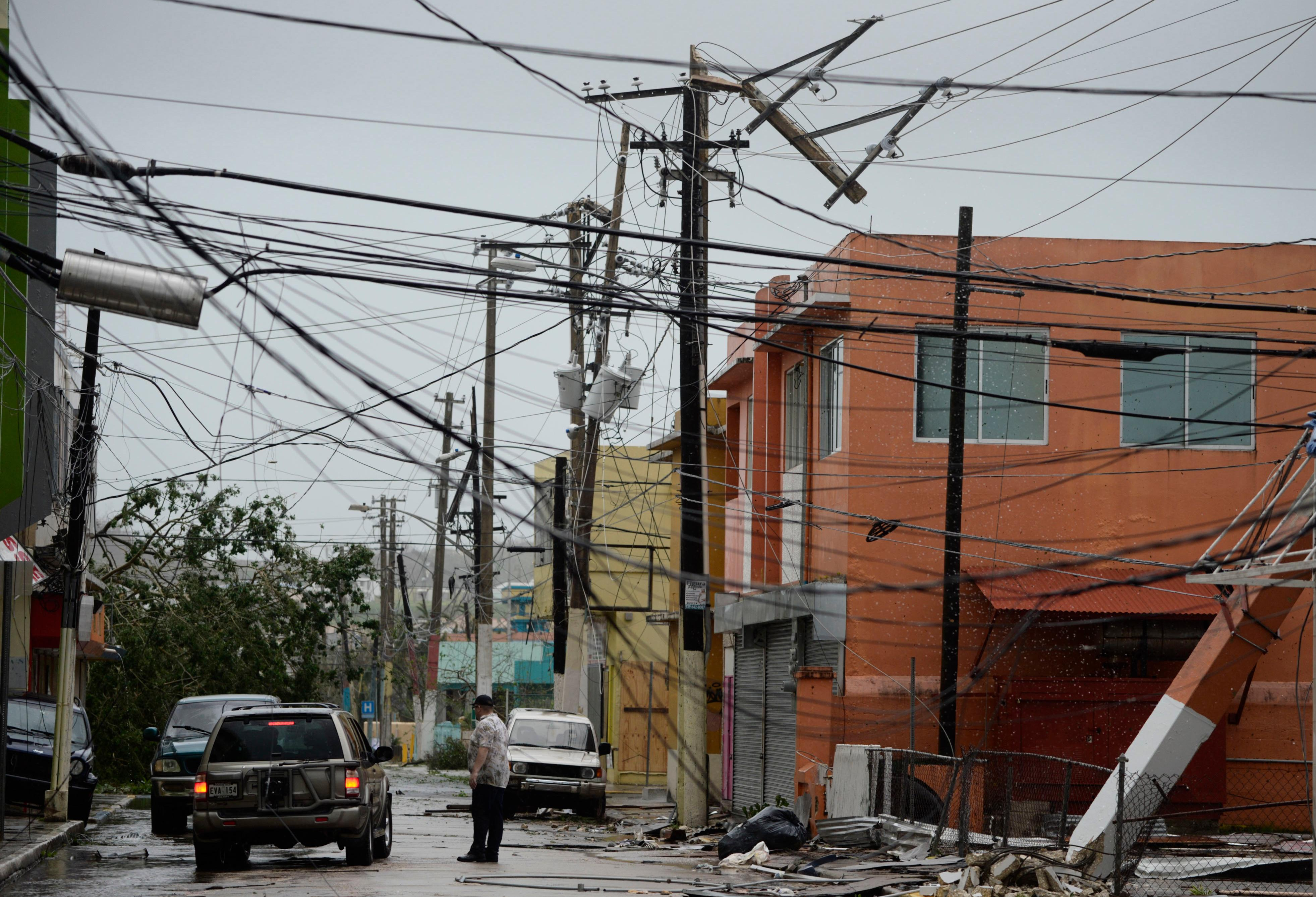 Power lines are down after the impact of Hurricane Maria, which hit the eastern region of the island in Humacao, Puerto Rico, Wednesday, Sept. 20, 2017. (AP Photo/Carlos Giusti)