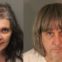 Parents arrested after police find 13 children, ages 2 to 29, shackled with chains