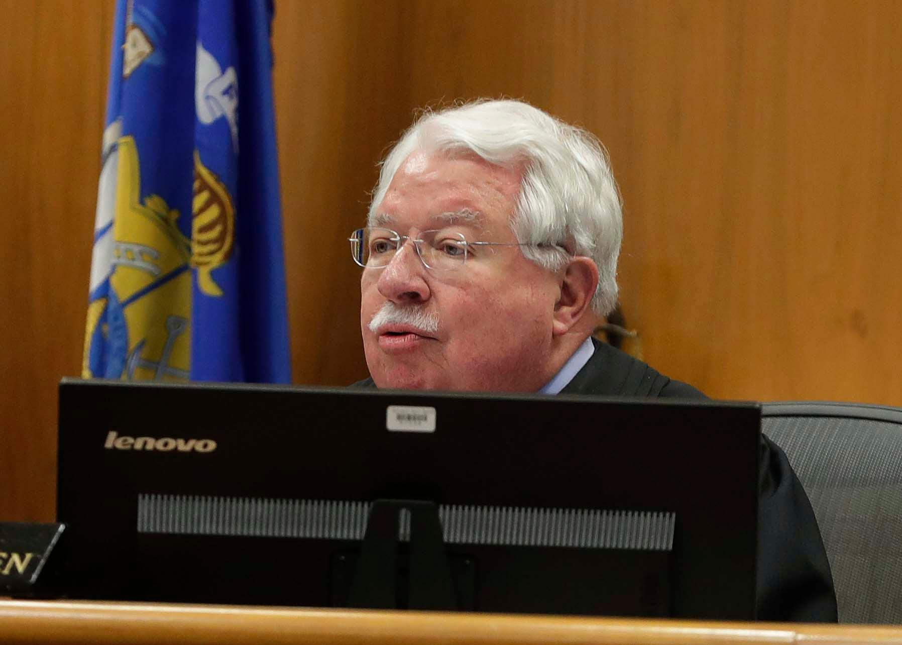 Waukesha County Circuit Judge Michael Bohren, begins the sentencing phase in the trial of Morgan Geyser, Thursday, Feb. 1, 2018 in Waukesha, Wis.   Geyser is one of two girls who tried to kill a classmate with a knife to appease fictional horror character Slender Man.  Prosecutors want Geyser to spend the maximum 40 years in a mental hospital for stabbing Payton Leutner in suburban Milwaukee in 2014.  (Rick Wood/Milwaukee Journal-Sentinel via AP, Pool)