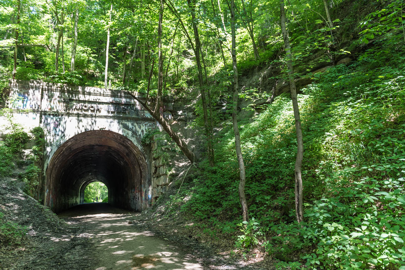 "The Moonville Tunnel is an old train tunnel in the town of the same name that's 2.5 hours east of Cincinnati. Moonville has been a ghost town since 1947. Today, the path of the tracks is a forested hiking route for anyone to enjoy. First published on July 8 in ""Welcome To Moonville, A Ghost Town In Southeastern Ohio"" / Image: Mike Menke"