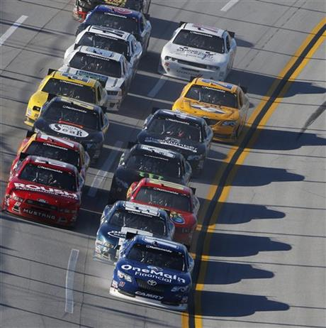 Elliott Sadler (11) leads a pack of cars during the NASCAR Aaron's 312 Nationwide series auto race at Talladega Superspeedway, Saturday, May 3, 2014, in Talladega, Ala.