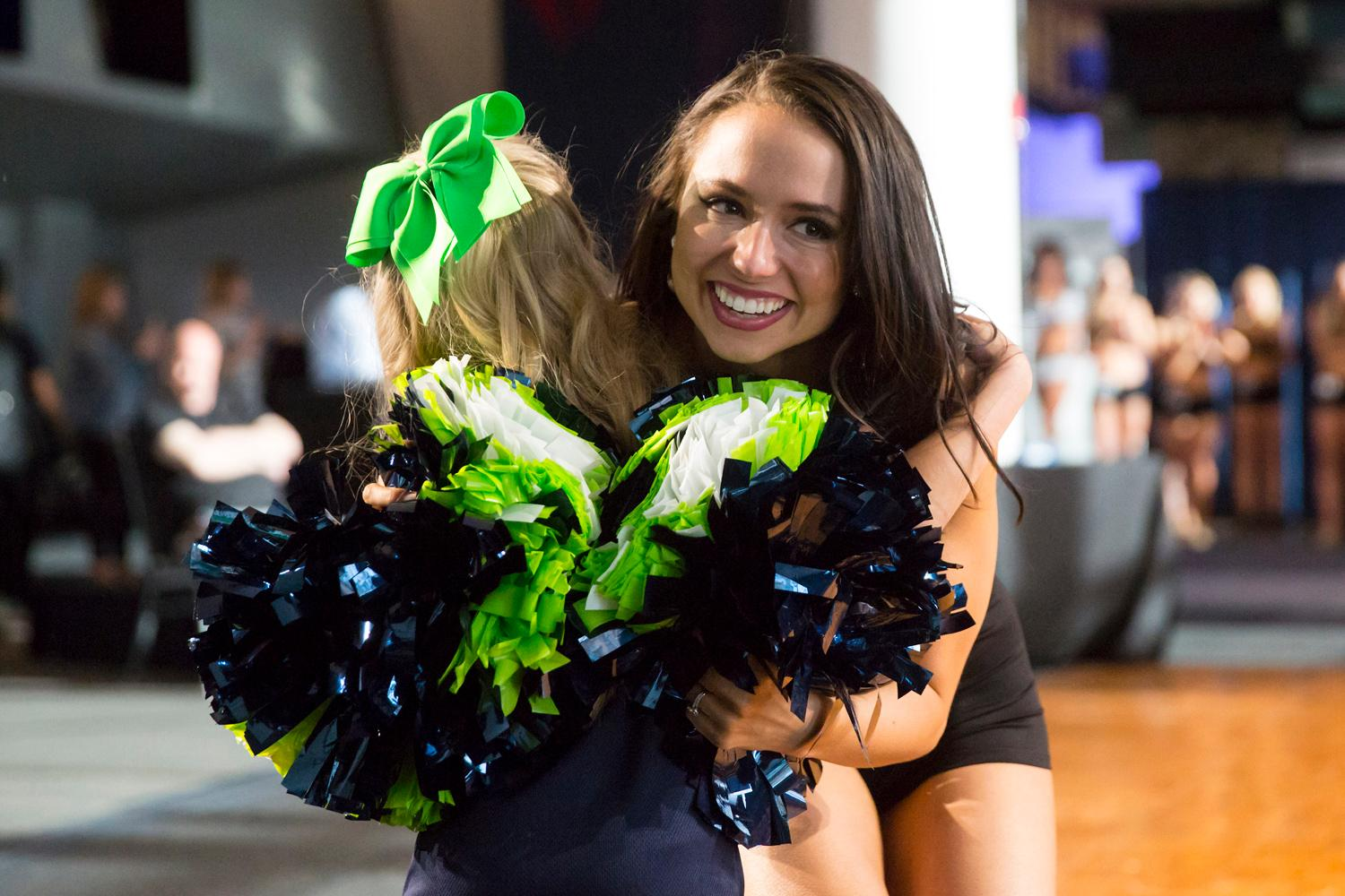 Welcome Katie, a 2018 Sea Gal! Dancers performed a choreographed routine and spoke briefly about themselves. The entire evening was live broadcasted on the Seahawks website. (Sy Bean / Seattle Refined)