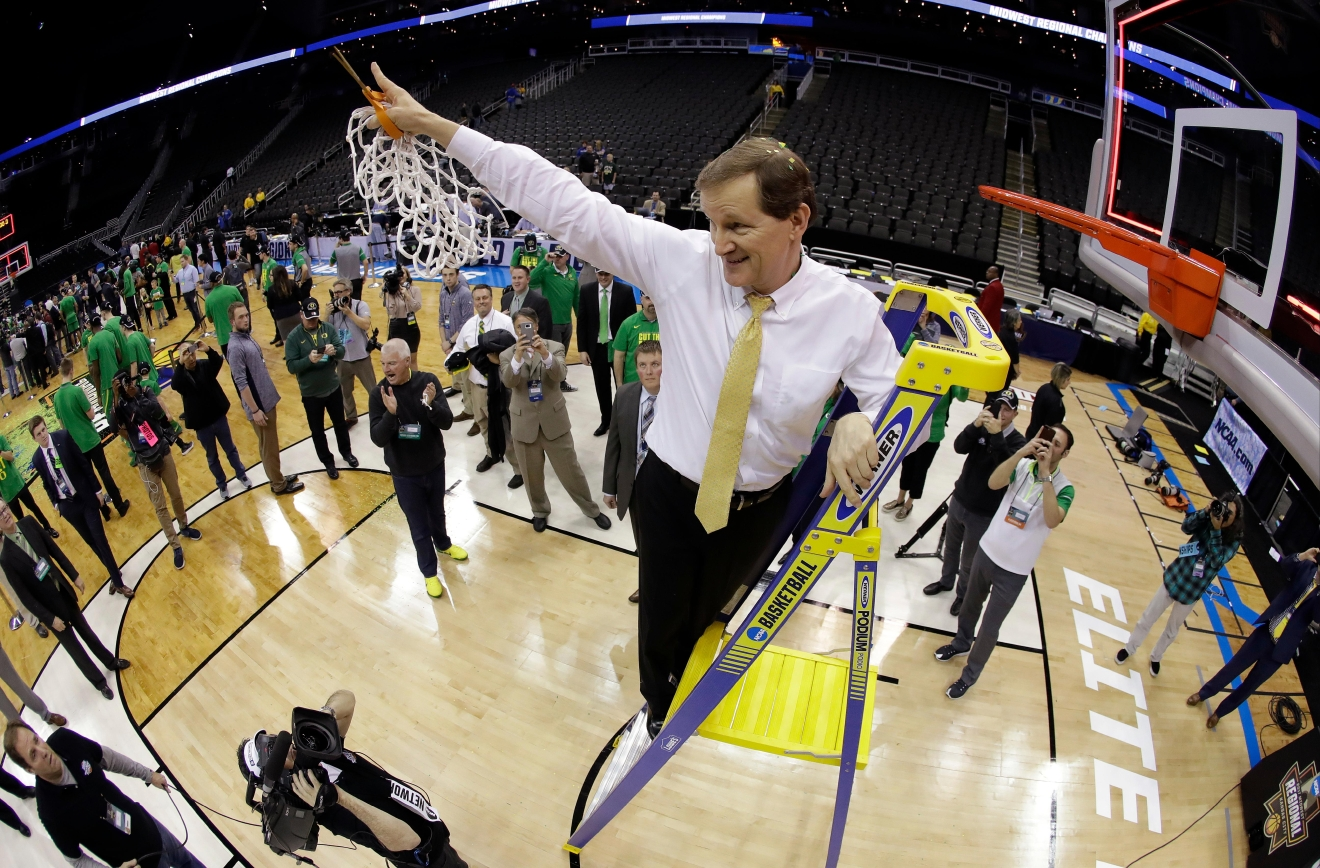 Oregon coach Dana Altman cuts down the net after the team's Midwest Regional final against Kansas in the NCAA men's college basketball tournament, Saturday, March 25, 2017, in Kansas City, Mo. Oregon won 74-60. (AP Photo/Charlie Riedel)