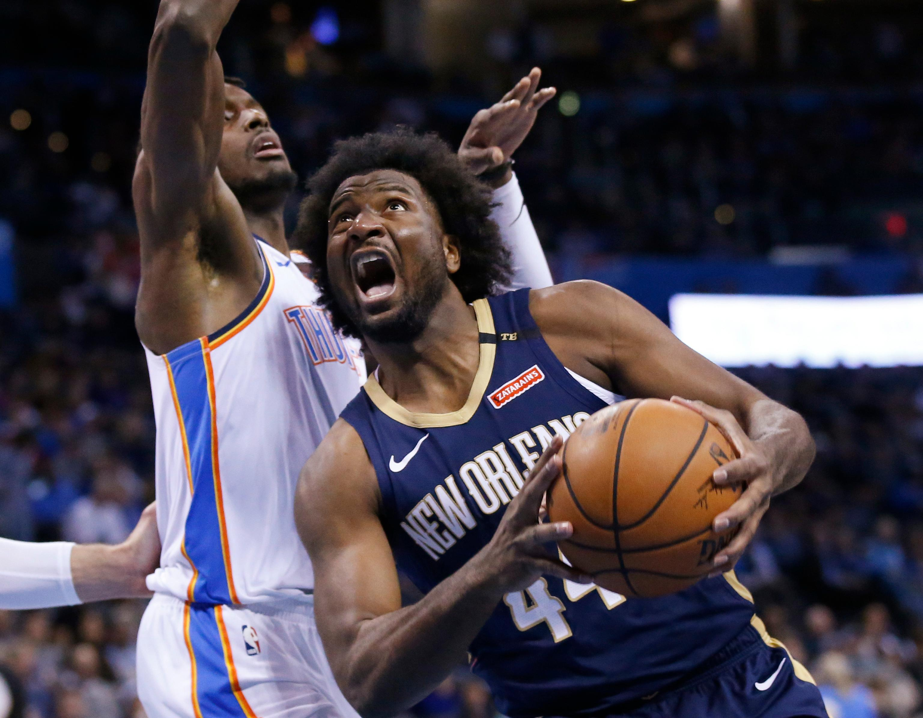 New Orleans Pelicans forward Solomon Hill (44) drives around Oklahoma City Thunder forward Jerami Grant, left, during the first half of an NBA basketball game in Oklahoma City, Thursday, Jan. 24, 2019. (AP Photo/Sue Ogrocki)
