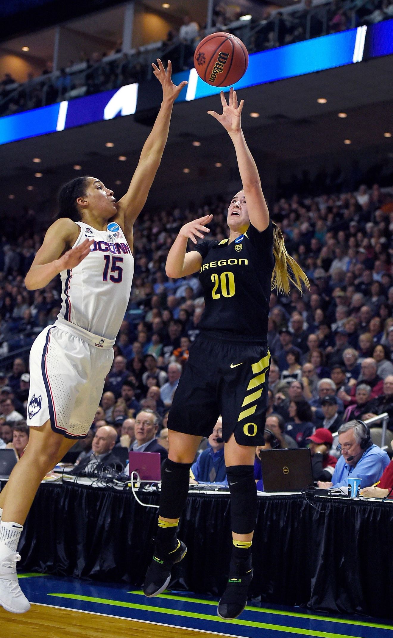 Oregon's Sabrina Ionescu, right, shoots over Connecticut's Gabby Williams during the first half of a regional final game in the NCAA women's college basketball tournament, Monday, March 27, 2017, in Bridgeport, Conn. (AP Photo/Jessica Hill)