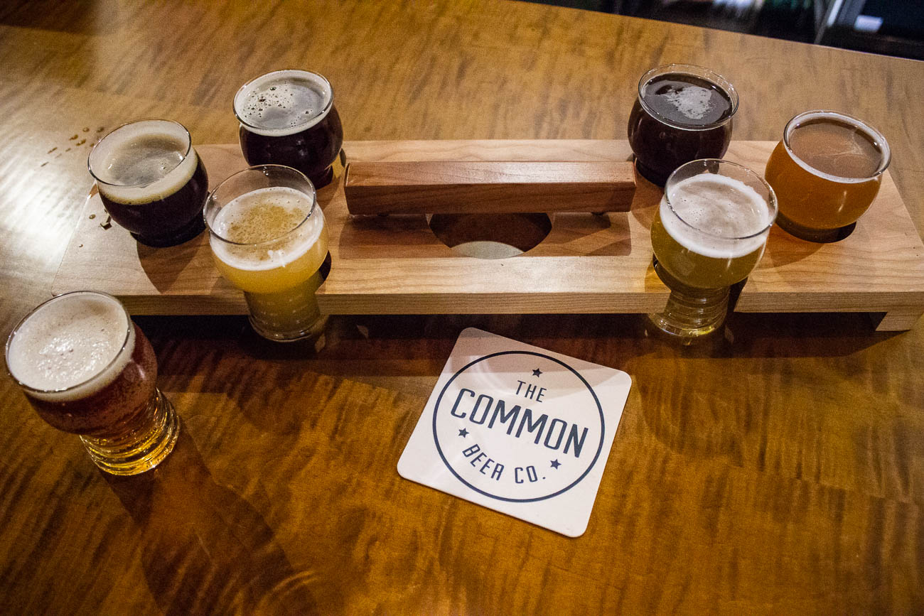 "You can find Common Beer Company in Mason. It is solely a local tap room, meaning they have no plans to distribute their beer to stores. Mark says he wanted the brewery to become a ""Mason destination"" so the neighborhood could identify itself in the ever-growing brewery market. What sets them apart from others is their varietals of beers, utilizing multiple locally sourced flavors rather than focusing on just one. They have 12 beers on tap, ciders from Tin Cap Cidery in Wilmington, and select wines. They've harvested flavors such as honey and coffee, but they also plan to incorporate the pawpaw—the Ohio State fruit that grows wildly throughout the area, but very few people know about. / Image: Katie Robinson, Cincinnati Refined // Published: 1.4.19"
