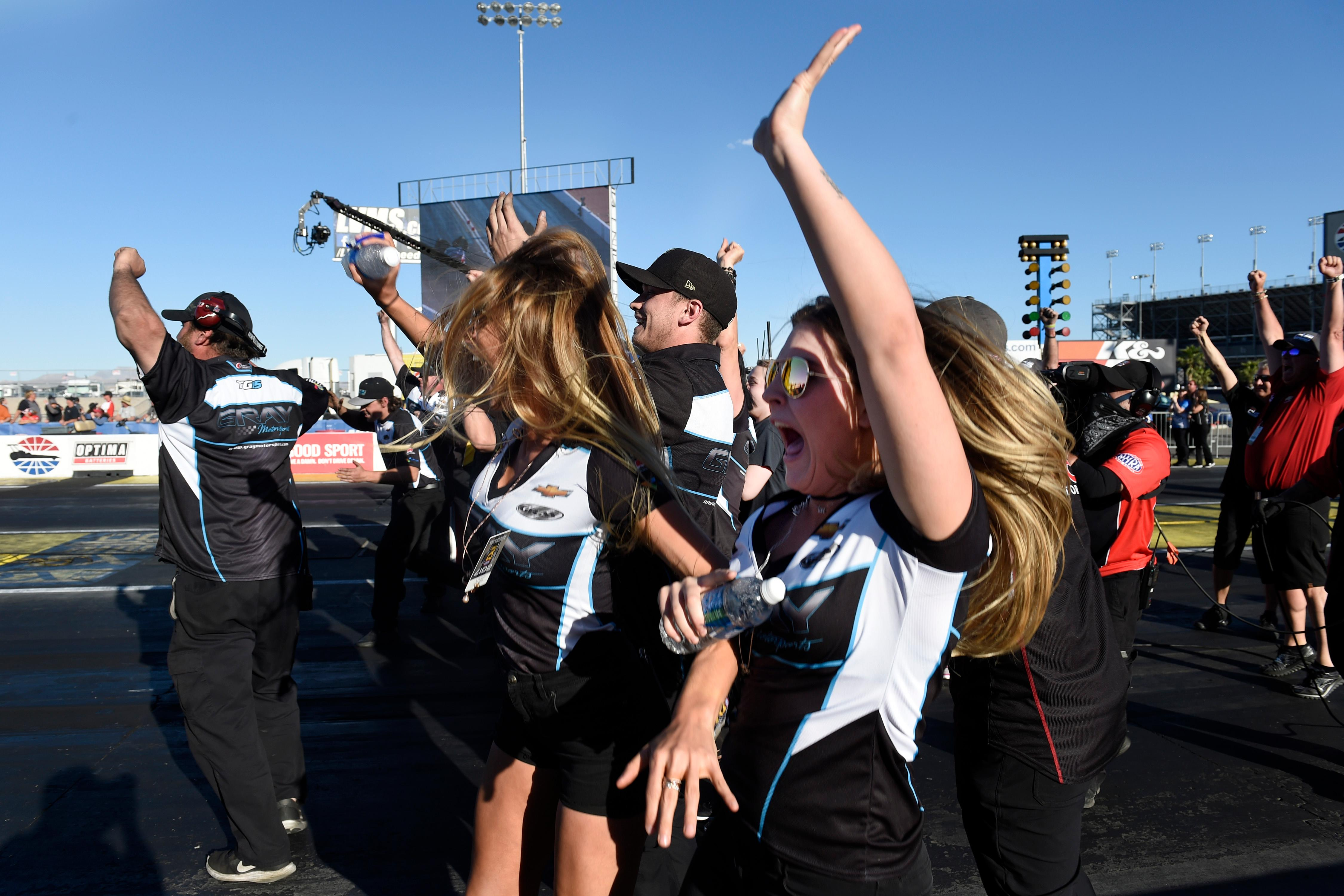 Family and Crew members of Funny Car driver Tommy Johnson Jr. celebrate as he takes the title during the NHRA DENSO Spark Plug Nationals at The Strip at the Las Vegas Motor Speedway Sunday, April 2, 2017. (Sam Morris/Las Vegas News Bureau)
