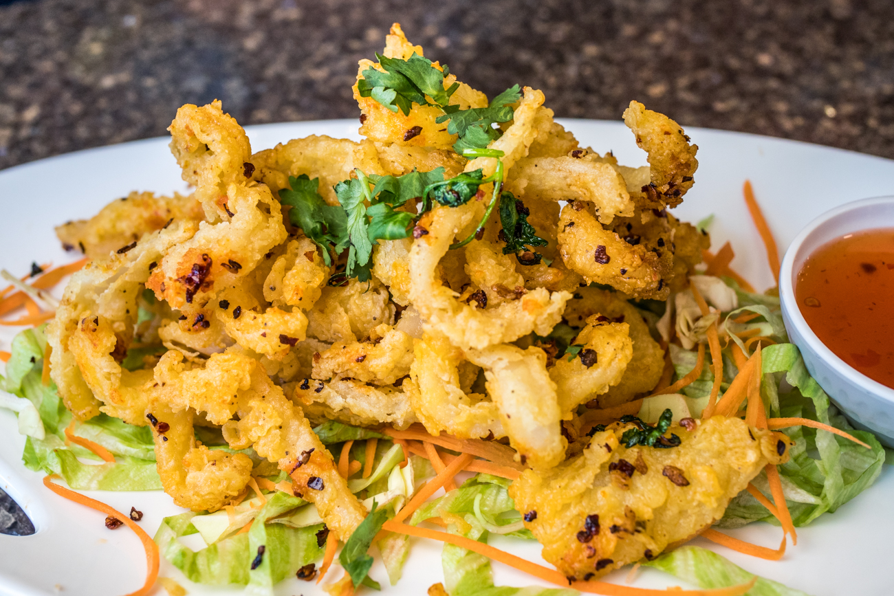 Spicy Fried Calamari: rice flour dusted calamari tossed with onion and fresh chili peppers and served with sweet chili sauce / Image: Catherine Viox // Published: 8.19.20