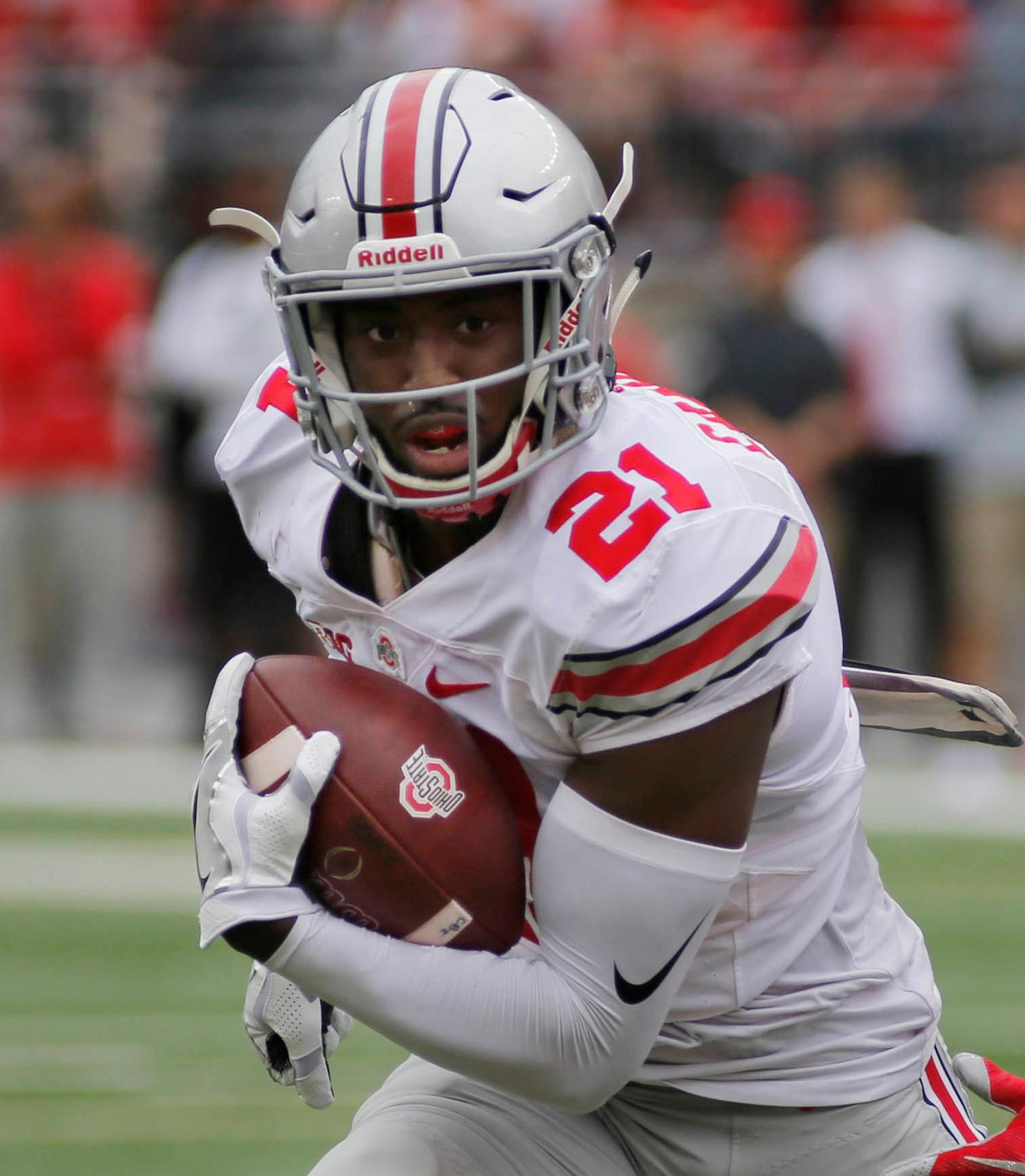 FILE - In this April 15, 2017, file photo, Ohio State wide receiver Parris Campbell runs the ball during their NCAA college spring football game in Columbus, Ohio. Campbell will be back with the Buckeyes next season. (AP Photo/Jay LaPrete, File)