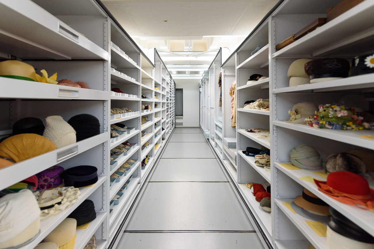 Inside the shelves, everything from hats to shoes are kept. Preserving these articles of clothing is a tricky business, sometimes resulting in quirky ways to stack and store each piece. / Image: Phil Armstrong, Cincinnati Refined // Published: 2.18.20