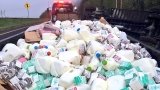 Semi loaded with milk cartons rolls off interstate ramp
