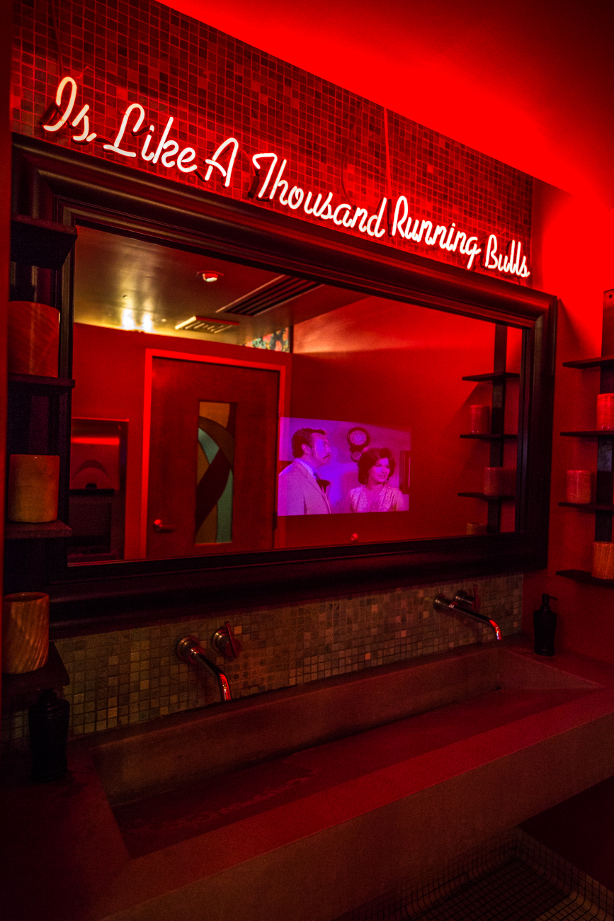 PLACE #5: Nada / ADDRESS: 600 Walnut Street (45202) / Nada's bathroom has it all: neon lights with fun quotes, floral wallpaper, stunning tiles, a movie playing in the mirror above the sinks, and even a powder station with LED mirrors so you can fix your makeup. / Image: Catherine Viox // Published: 8.8.19
