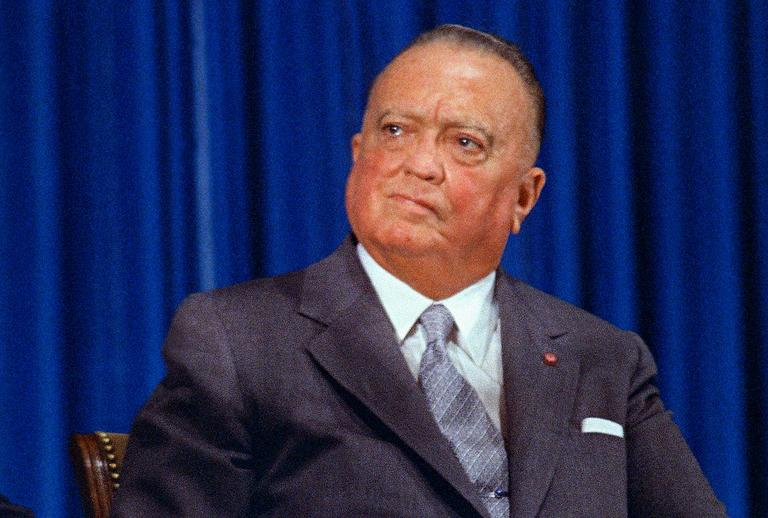 "FILE - In this July 1, 1971, file photo, FBI Director J. Edgar Hoover, is shown at the graduation ceremonies for the Federal Bureau of Investigation in Washington.   Government informants are an age-old investigative tactic that's as much a part of the FBI's 110 years of history as J. Edgar Hoover or its ""10 Most Wanted"" list.   (AP Photo/Harvey Georges)"