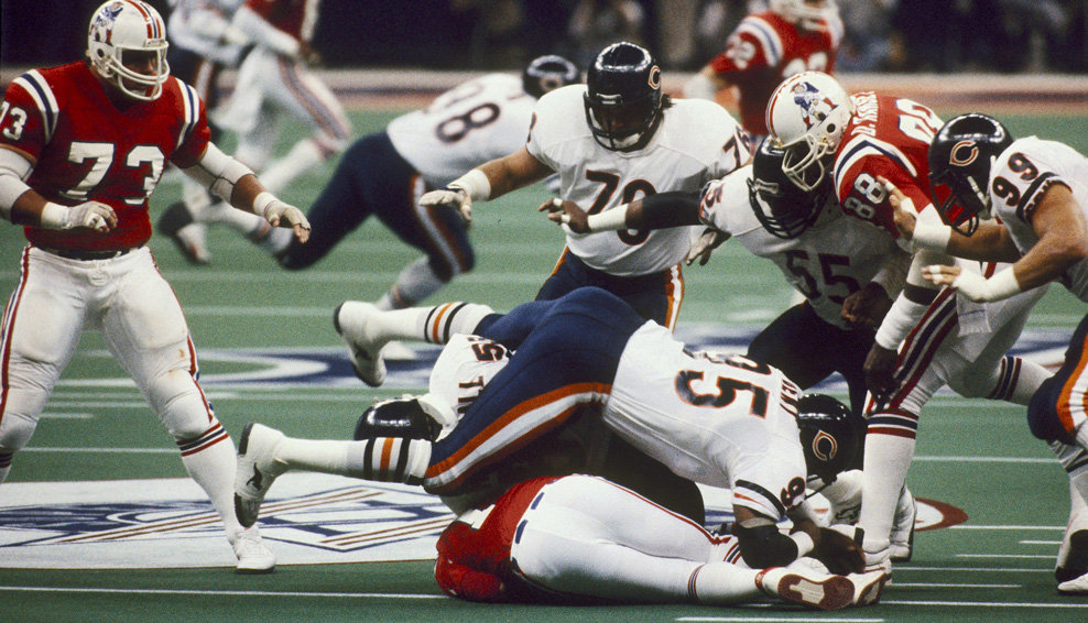 Chicago Bears defensive end Richard Dent (95) and linebacker Wilber Marshall(58) sack New England Patriots quarter back Steve Grogan (14) during Super Bowl XX on Jan. 26, 1986, at the Louisana Superdome in New Orleans. The Bears won, 46-10. (Photo by Sylvia Allen/Getty Images)