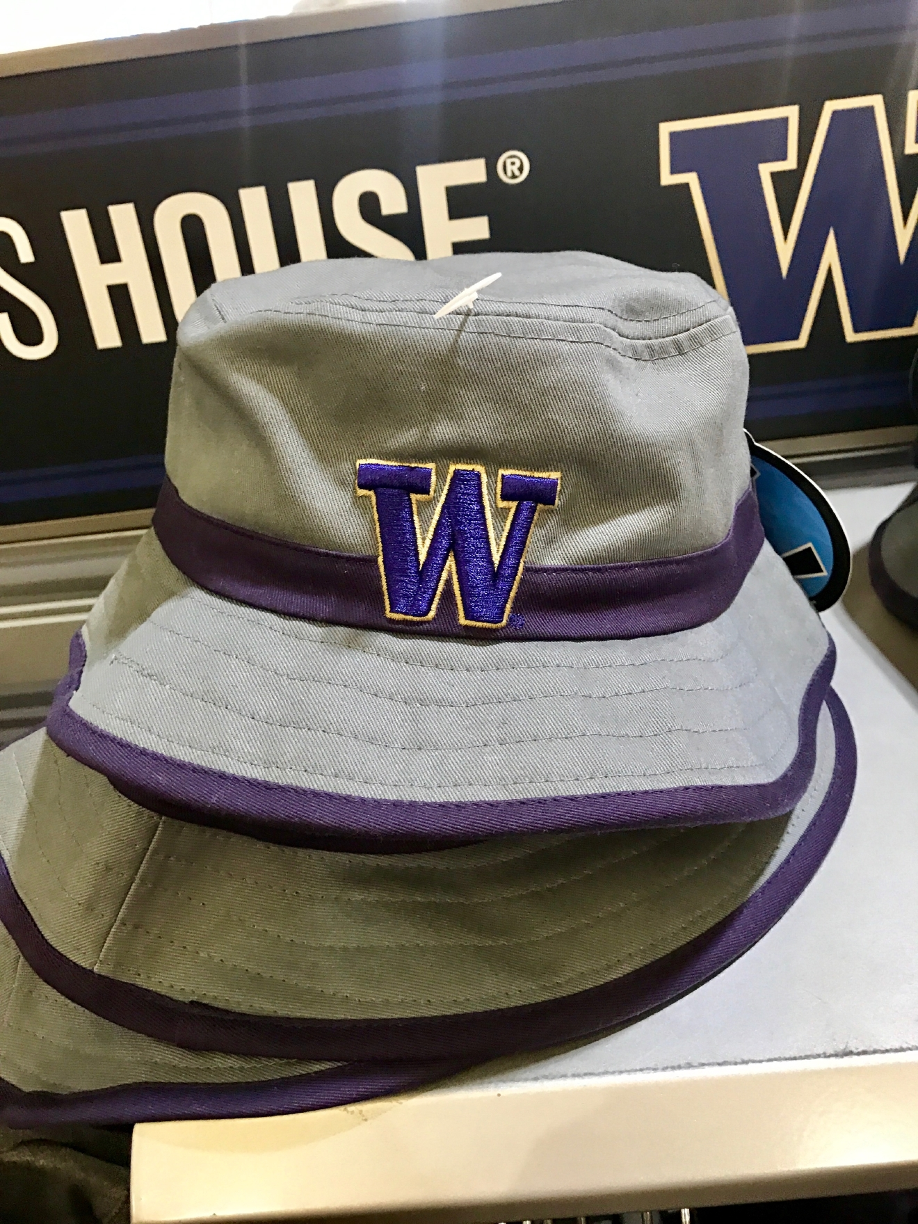 UW Bucket Hat - $29.99                                          Whether you're a current student, alum, or just *love* the Dawgs, it's a pretty exciting time to be a Husky fan right now. Just to catch you up, the University of Washington football team is having one of their best seasons in years, and will be playing the Peach Bowl in Atlanta on December 31st. If you know a Dawg fan, they're probably salivating at the mouth right about now. Which is why it's a perfect time to give them a themed gift! Here are some of the coolest Husky gear we saw at the University Bookstore on the Avenue during our last visit. Pro Tip: They're open 10 a.m. - 7 p.m. on Christmas Eve! (Image: Britt Thorson / Seattle Refined)