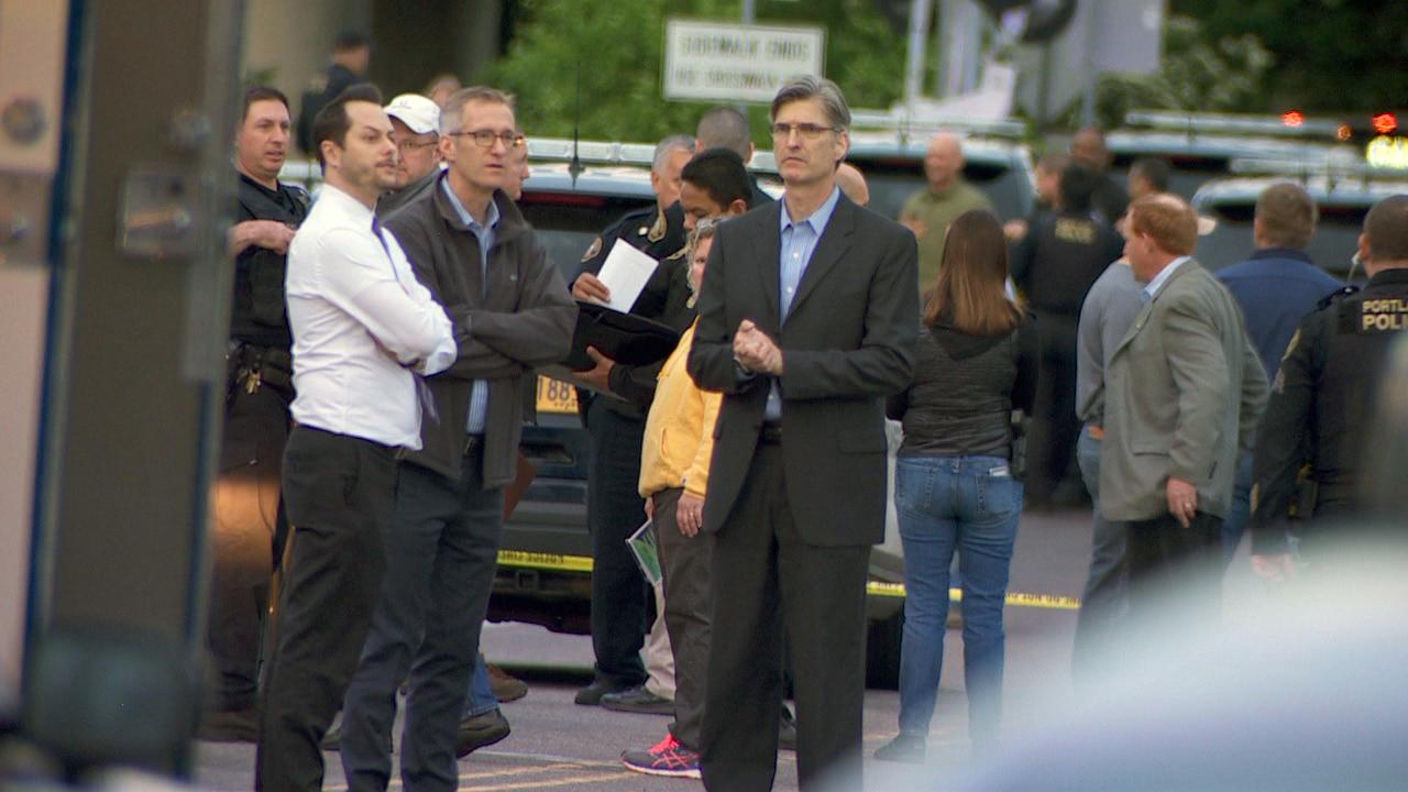 Portland Mayor Ted Wheeler and Police Chief Mike Marshman at the scene of a deadly officer-involved shooting Wednesday night, May 10, 2017 near Southeast 92nd Avenue and Flavel Street. The man in the white shirt is Wheeler's spokesman, Michael Cox. (KATU Photo)