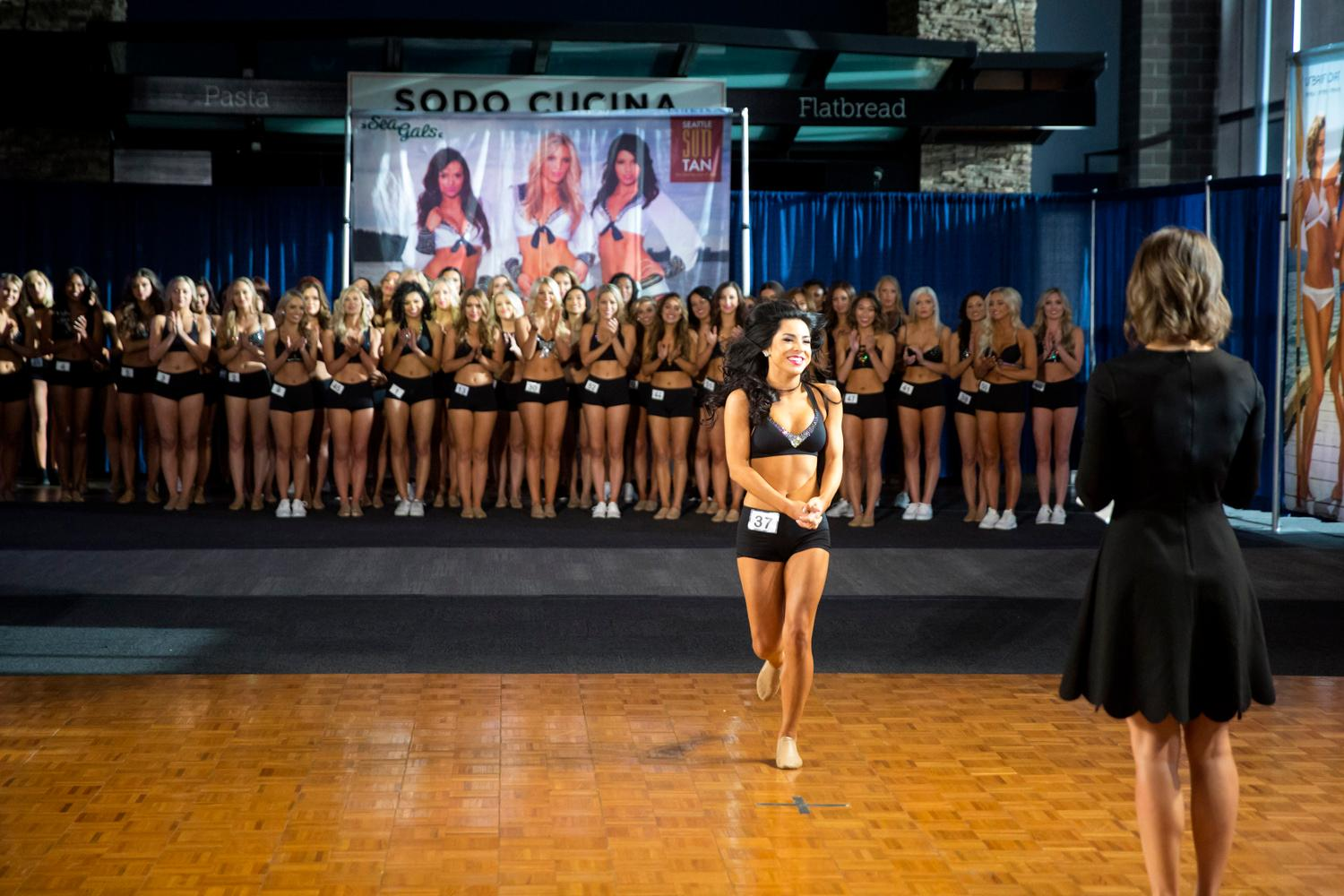 Welcome Jessica, a 2018 Sea Gal! Dancers performed a choreographed routine and spoke briefly about themselves. The entire evening was live broadcasted on the Seahawks website. (Sy Bean / Seattle Refined)