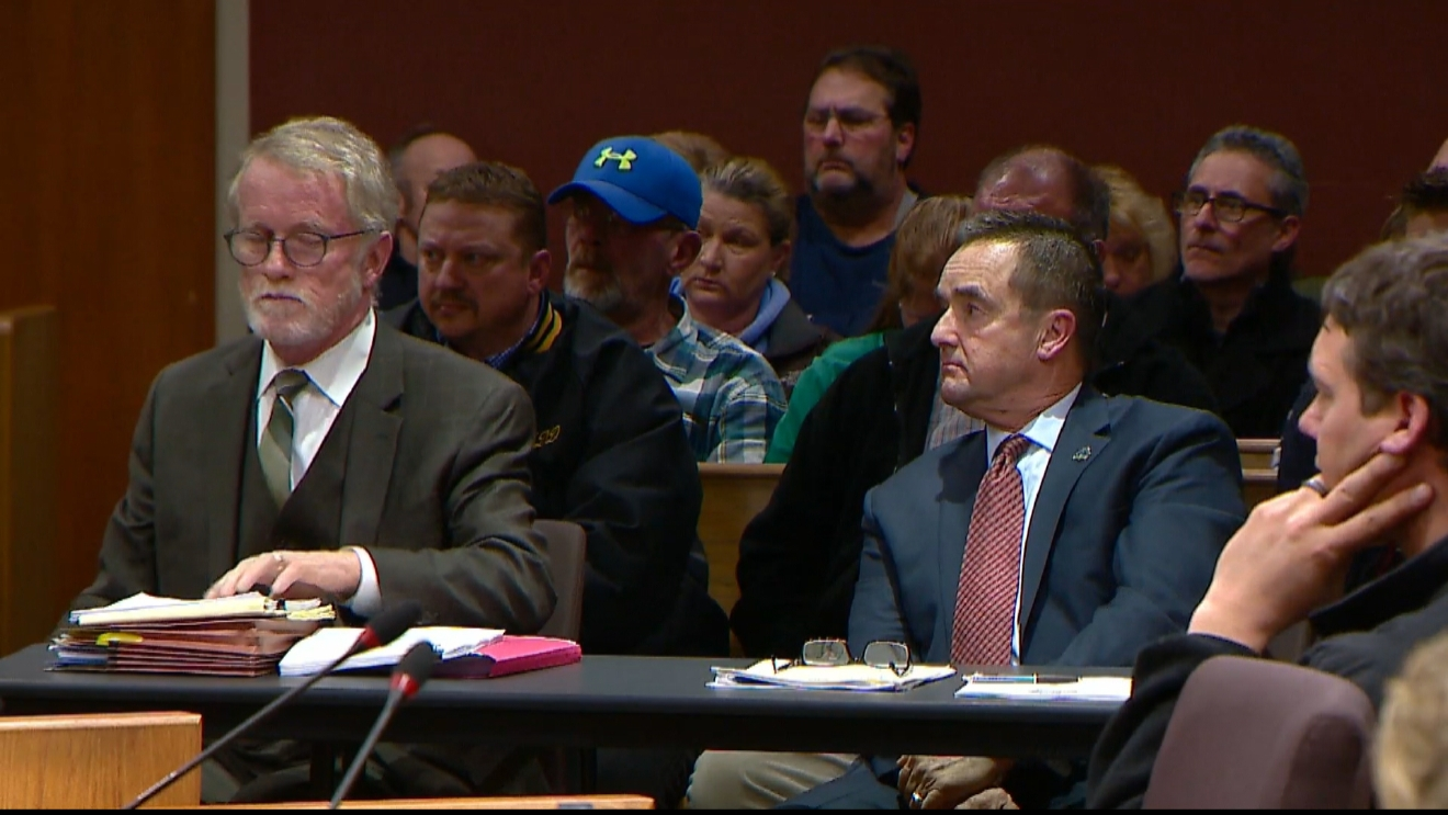Green Bay Mayor Jim Schmitt sits along side his attorney, Patrick Knight, during a removal hearing, February 20, 2017. (WLUK/Andy Harbath)
