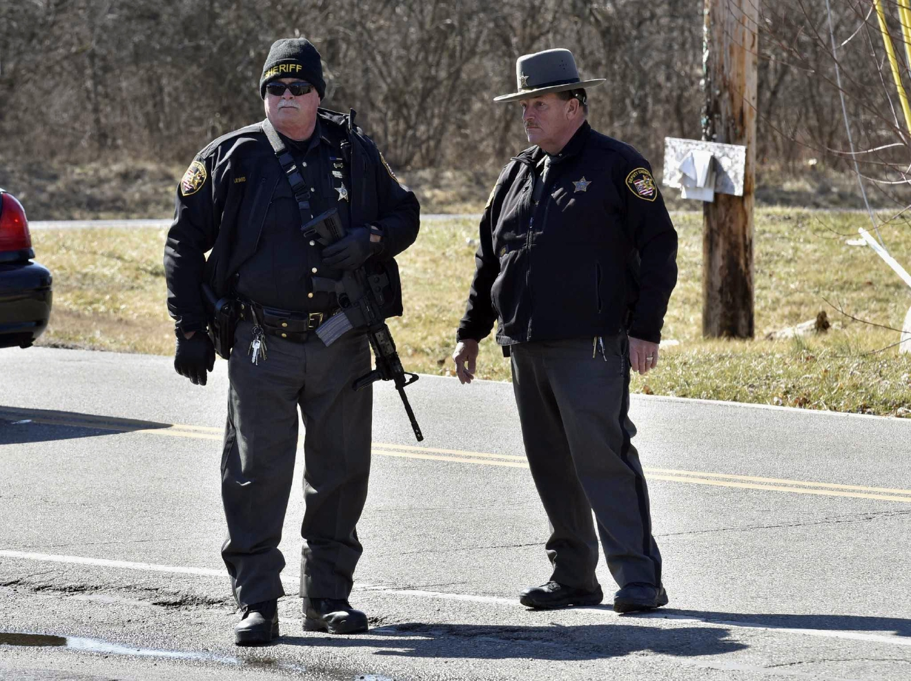 Deputies stand guard Monday, Feb. 29, 2016, near Middletown, Ohio after a school shooting at Madison Local Schools.  An Ohio sheriff says a 14-year-old suspect in a school shooting that wounded four classmates, including two who were shot, is in a juvenile lock-up and facing several charges. Butler County Sheriff Richard Jones says the boy has been charged with two counts of attempted murder, two counts of felonious assault, inducing panic and making terrorist threats.  (Nick Graham/Dayton Daily News via AP)