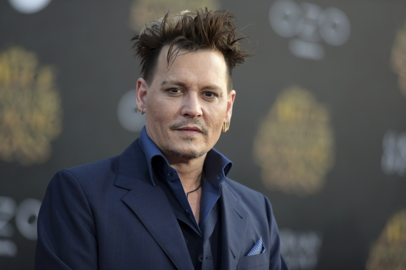 "FILE - In this May 23, 2016 file photo, Johnny Depp arrives at the premiere of ""Alice Through the Looking Glass"" at the El Capitan Theatre, in Los Angeles. Depp's former business managers countersued the actor on Tuesday, Jan. 31, 2017, stating that they frequently advised him that his spending was out of control. Depp sued his former business managers earlier this month alleging they mismanaged his money. (Photo by Richard Shotwell/Invision/AP, File)"