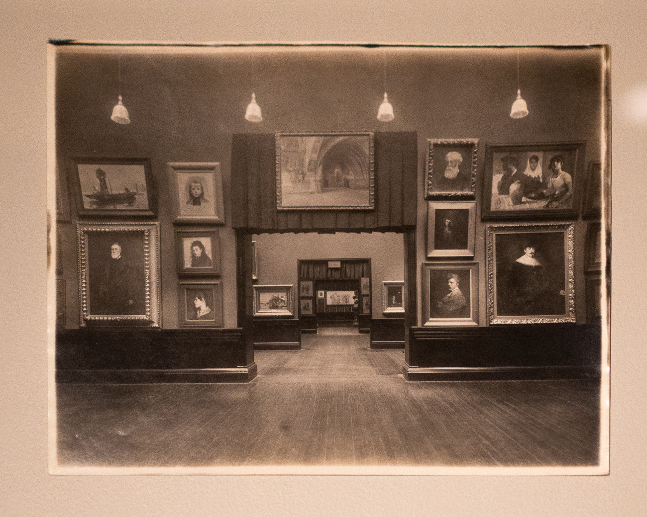 Also in the collection are rare photographs of Duveneck and those in his life. This photo shows the Cincinnati Art Museum hung with Duveneck works salon-style. / Image: Phil Armstrong, Cincinnati Refined // Published: 12.19.20