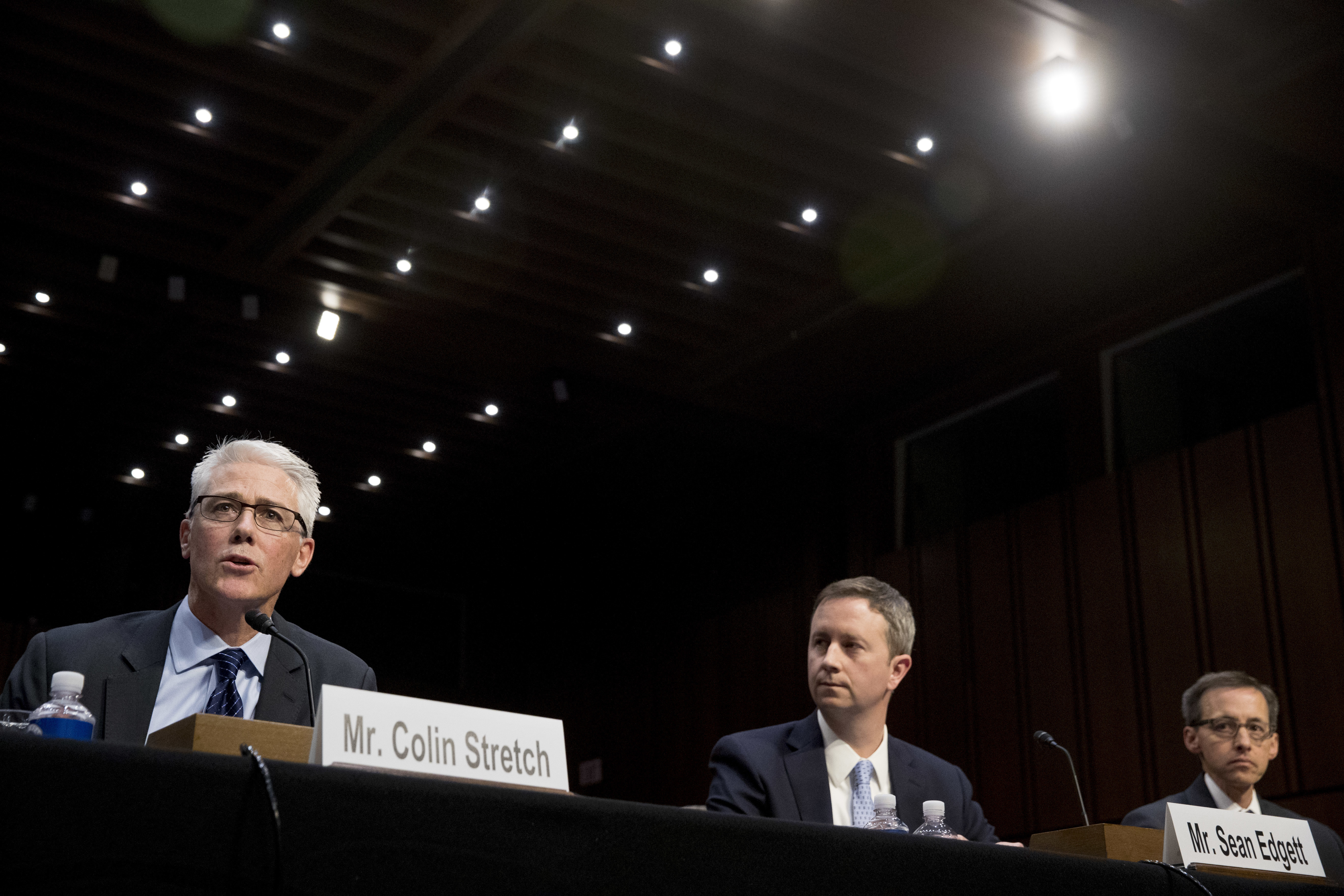 From left, Facebook's General Counsel Colin Stretch, accompanied by Twitter's Acting General Counsel Sean Edgett, and Google's Law Enforcement and Information Security Director Richard Salgado, speaks during a Senate Committee on the Judiciary, Subcommittee on Crime and Terrorism hearing on Capitol Hill in Washington, Tuesday, Oct. 31, 2017, on more signs from tech companies of Russian election activity. (AP Photo/Andrew Harnik)