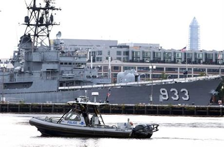 A police boat patrols near the scene of a shooting at the Washington Navy Yard on Monday, Sept. 16, 2013, in Washington. At least one gunman opened fire inside a building at the Washington Navy Yard on Monday morning.