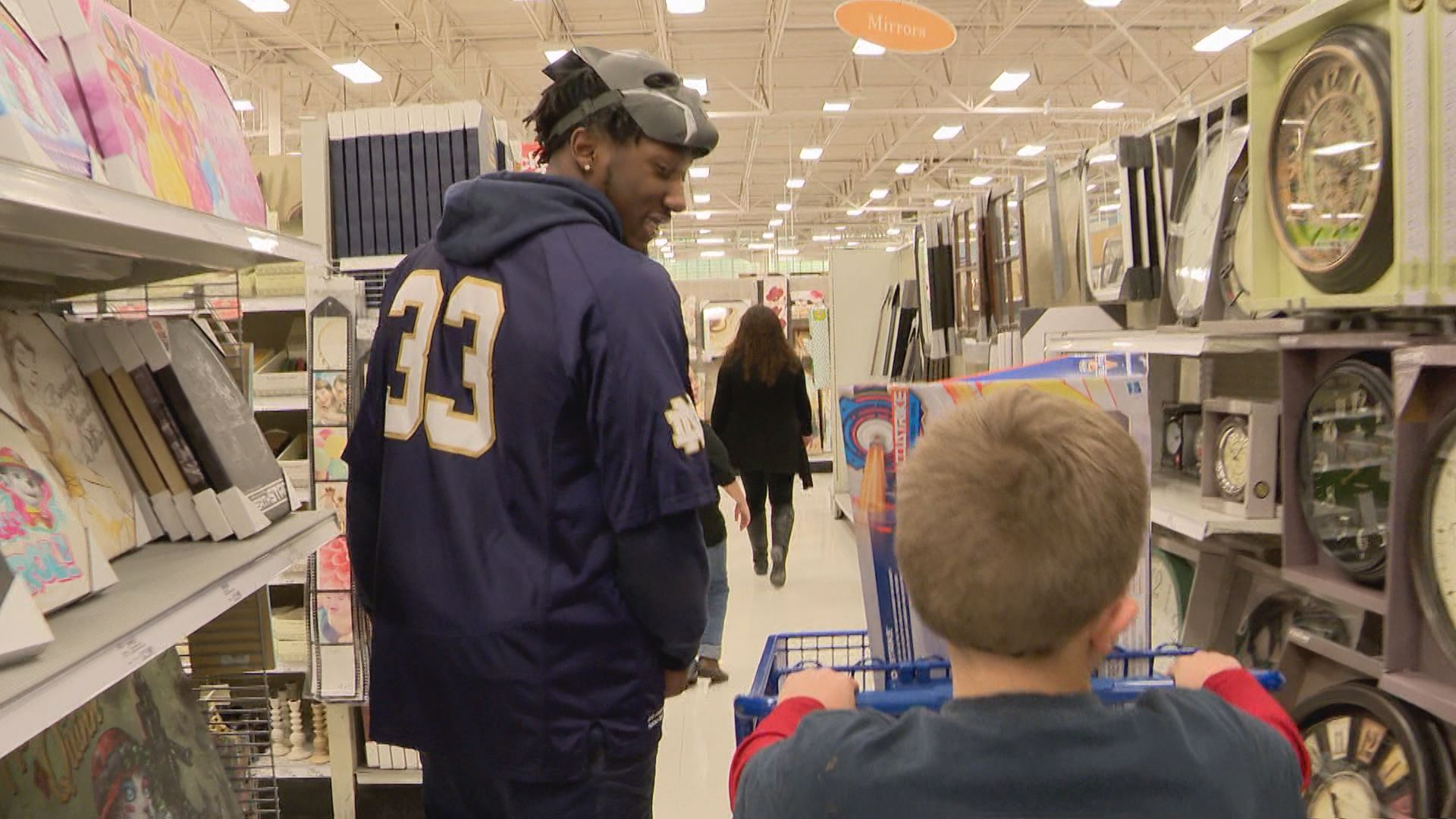 Josh Adams searches for the craft section with local children in 6th annual Shop with a Player event // WSBT 22 Photo<p></p>