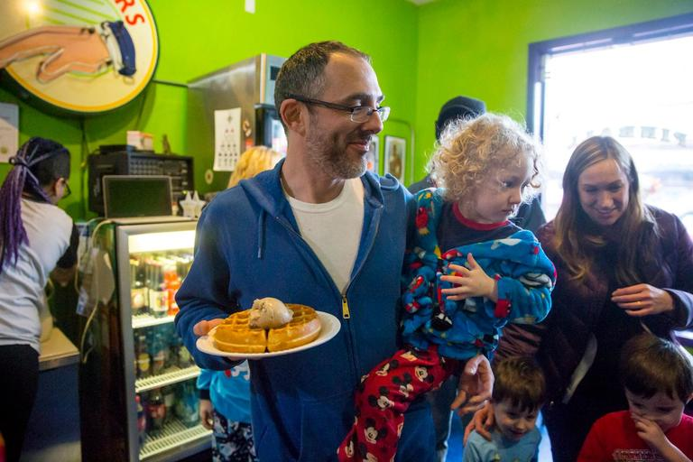Adam Kestler and his son Ezra grab a waffle with ice cream for Eat Ice Cream for Breakfast Day! at Full Tilt Ice Cream!! Their location in White Center encouraged guests to dress in their pajamas and eat some breakfast-themed ice cream flavors. Happy weekend! (Sy Bean / Seattle Refined)