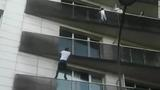 Watch: Migrant scales building to rescue dangling child