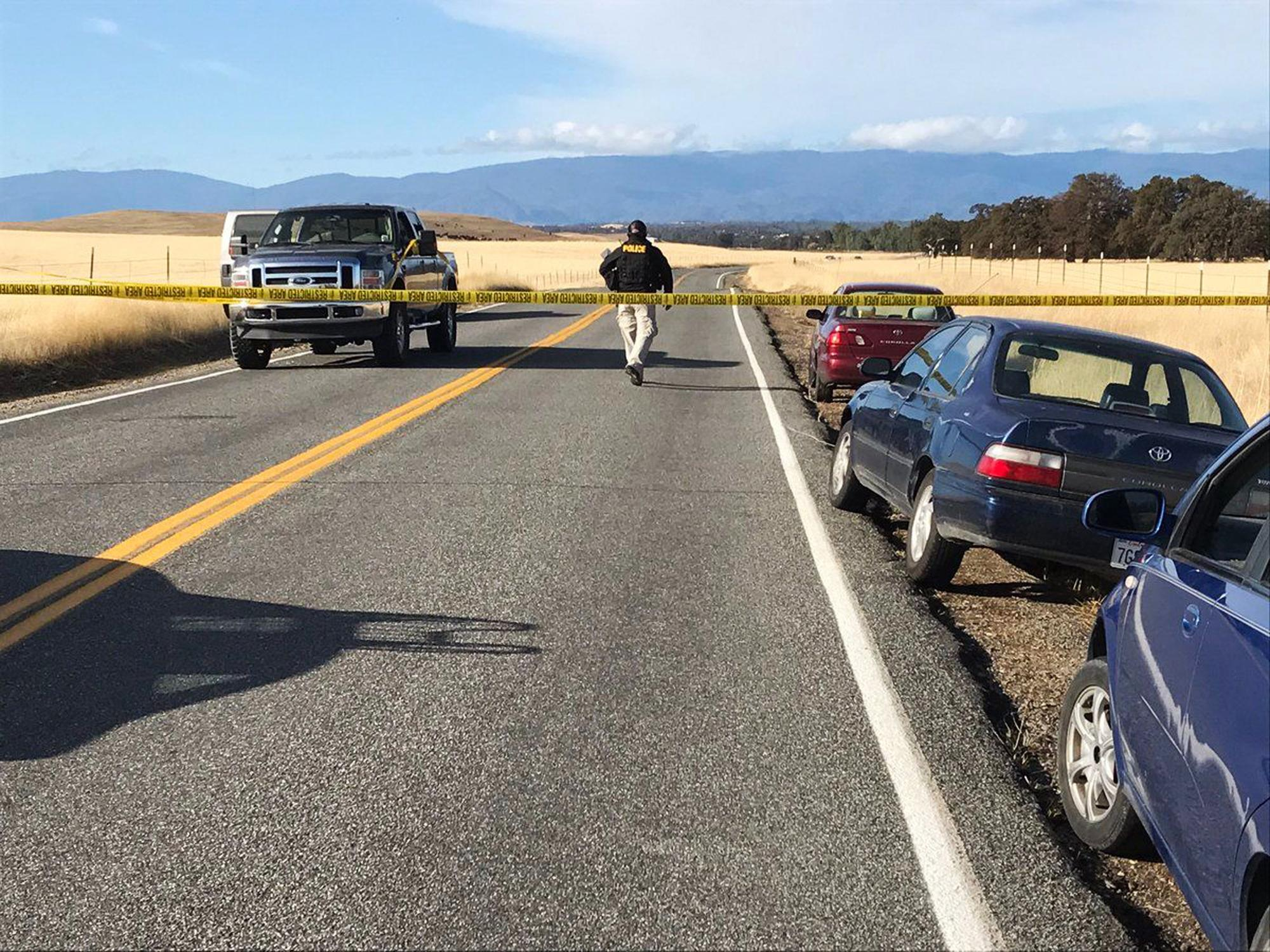 Crime tape blocks off Rancho Tehama Road leading into the Rancho Tehama subdivision south of Red Bluff, Calif., following a fatal shooting on Tuesday, Nov. 14, 2017. (Jim Schultz/The Record Searchlight via AP)