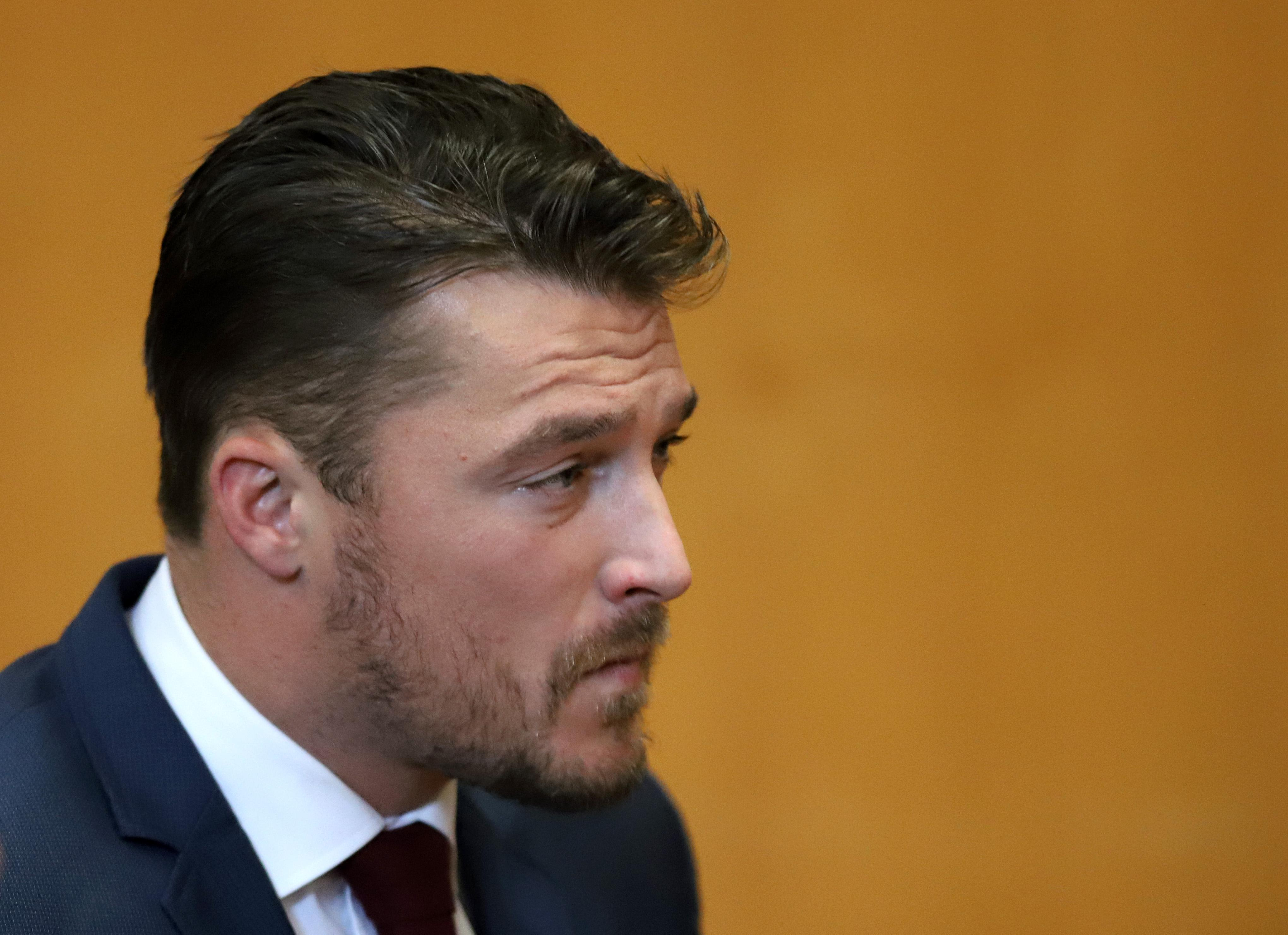 Chris Soules appears for a hearing in Buchanan County District Court with his lawyer Robert Montgomery Thursday, Sept. 14, 2017, in Independence, Iowa. Reality TV star Soules is charged with leaving the scene in a fatal April crash near Aurora, Iowa. (MATTHEW PUTNEY, The Courier /POOL)