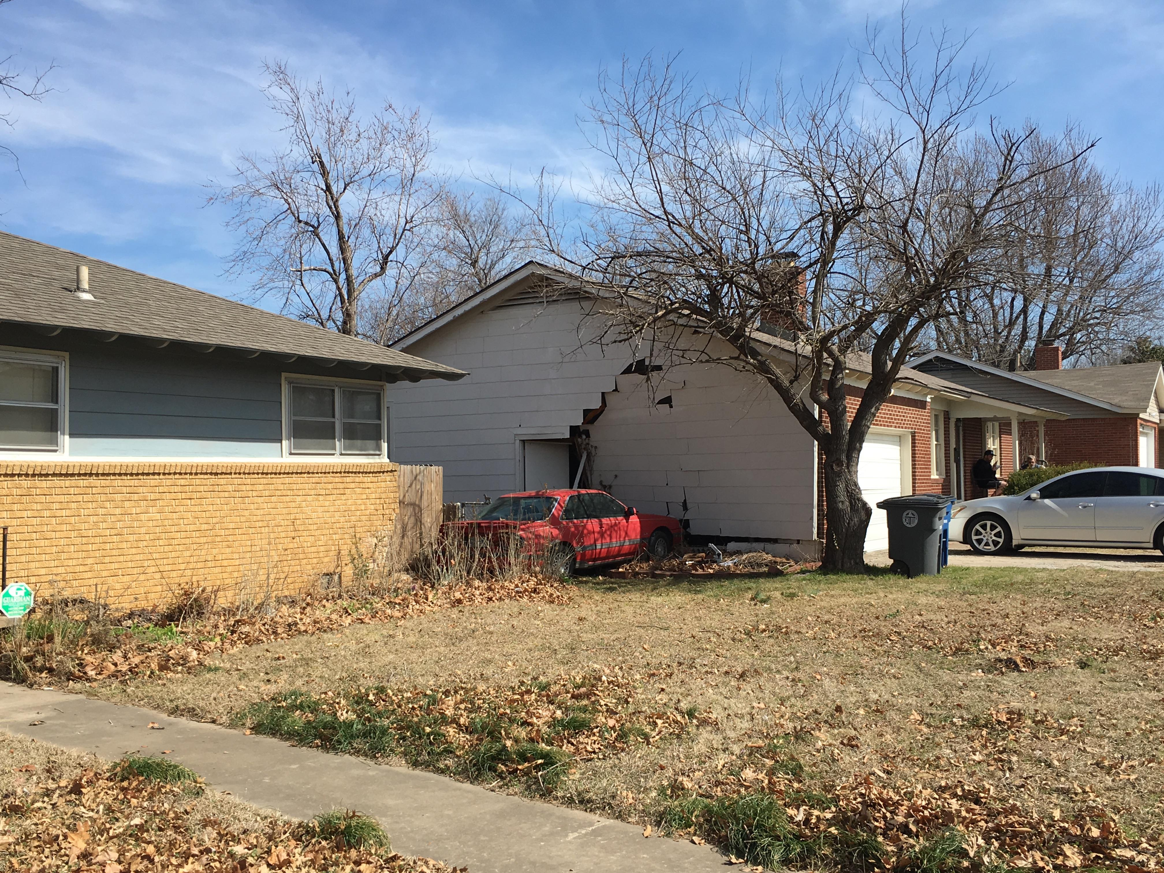 Officers responded just before 11 a.m. to a house near 4th and Harvard. Police say a red Mazda crashed into the home. (KTUL)