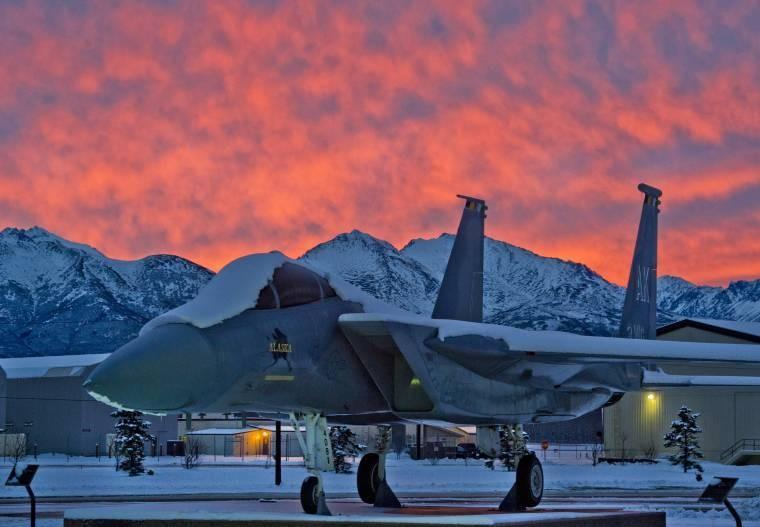 An F-15 Eagle sits on static display at Heritage Park near the 3rd Wing headquarters as the subarctic dawn breaks over Joint Base Elmendorf-Richardson, Alaska, Nov. 15, 2013.