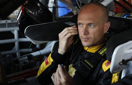 Driver Josh Wise prepares for practice as he sit in his car for Sunday's Aaron's 499 NASCAR auto race at Talladega Superspeedway on Friday, May 2, 2014, in Talladega, Ala.