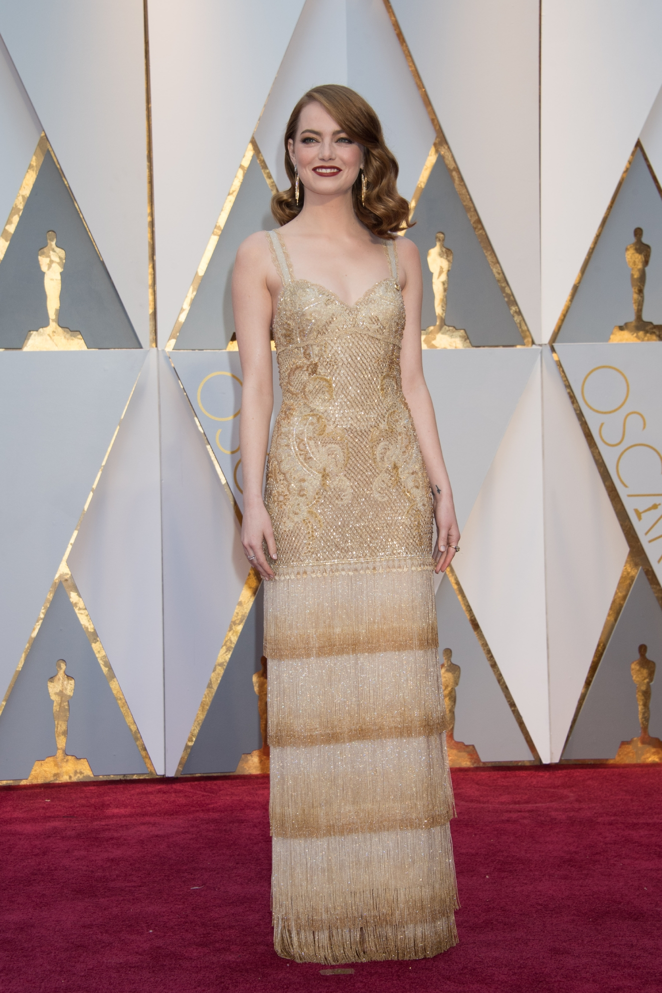 #5: Emma Stone. This nod to her movie, La La Land, is subtle and wonderful. Now that's a dancing dress! (Image: AMPAS)