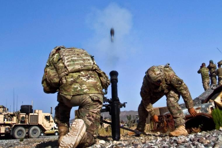 U.S. Army Spcs. Adam L. Cayton, and Sheign K. Hopson fire a 81mm mortar system during a live-fire training exercise in Afghanistan. Cayton and Hopson, indirect fire infantrymen, are assigned to the 101st Airborne Division's 1st Battalion.