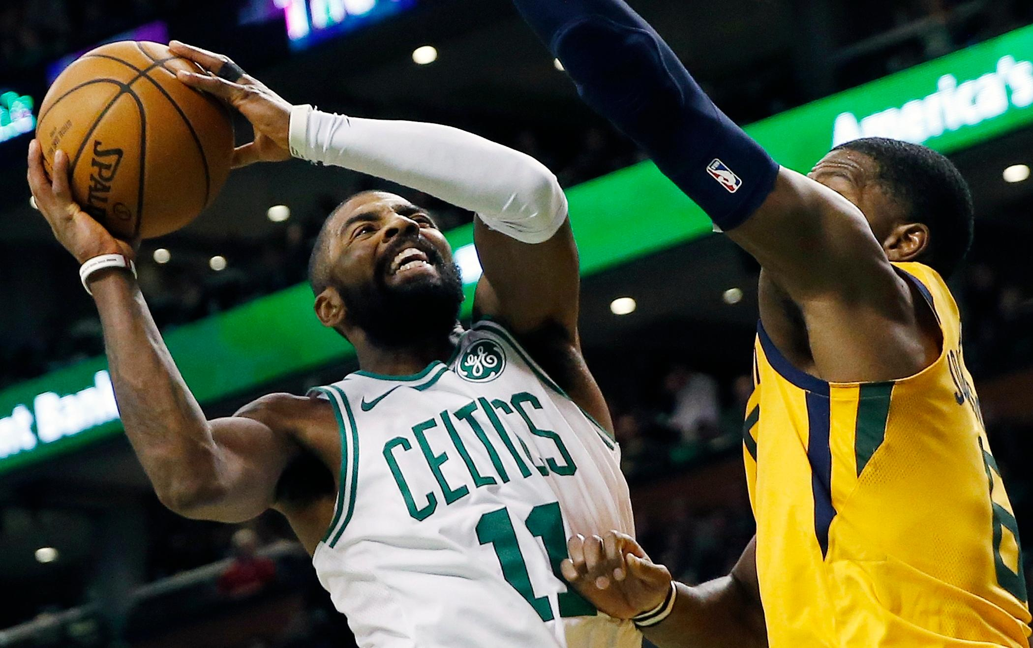Boston Celtics' Kyrie Irving (11) shoots against Utah Jazz's Joe Johnson (6) during the third quarter of an NBA basketball game in Boston, Friday, Dec. 15, 2017. (AP Photo/Michael Dwyer)