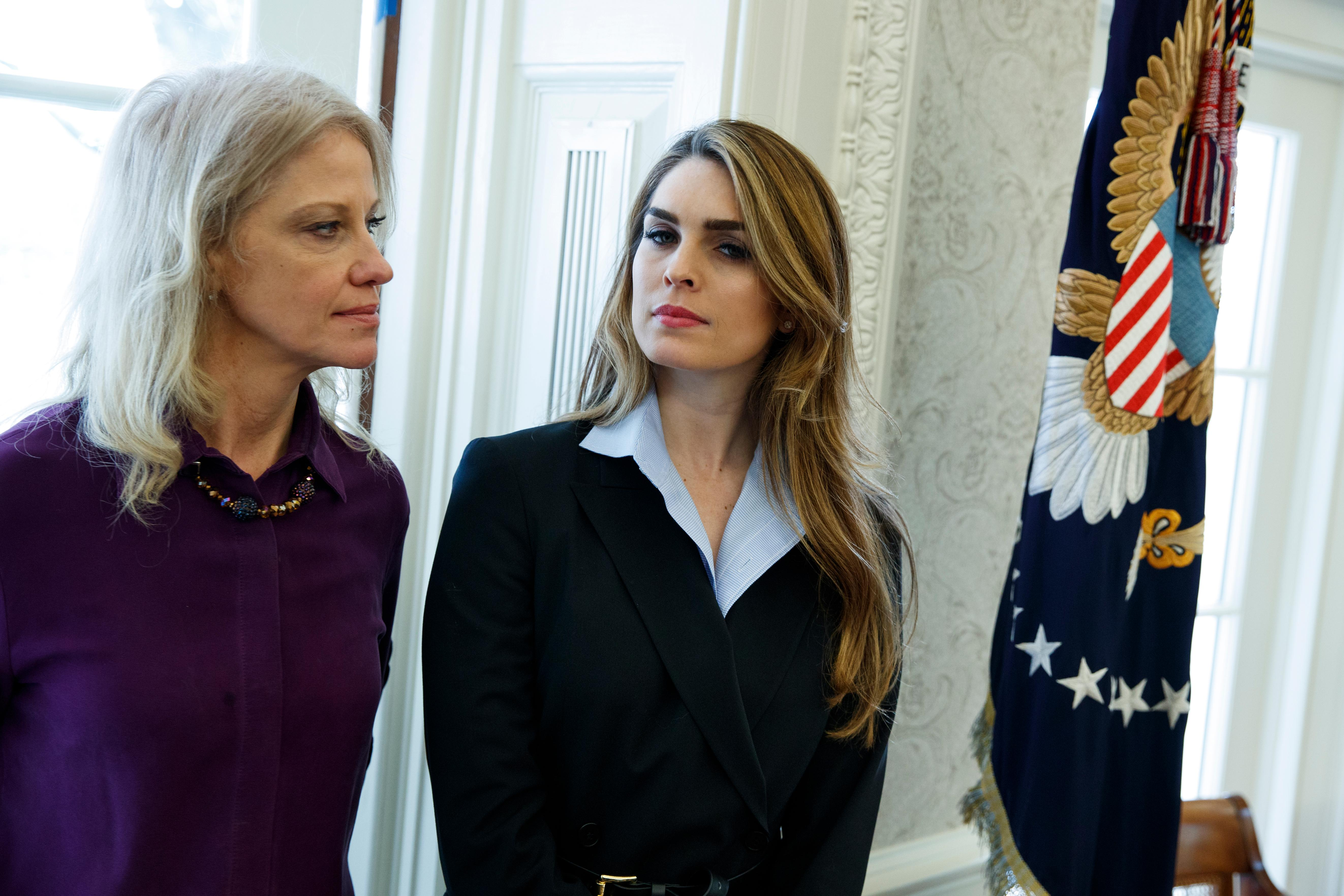 White House Communications Director Hope Hicks, right, stands with White House senior adviser Kellyanne Conway during a meeting in the Oval Office between President Donald Trump and Shane Bouvet, Friday, Feb. 9, 2018, in Washington. (AP Photo/Evan Vucci)