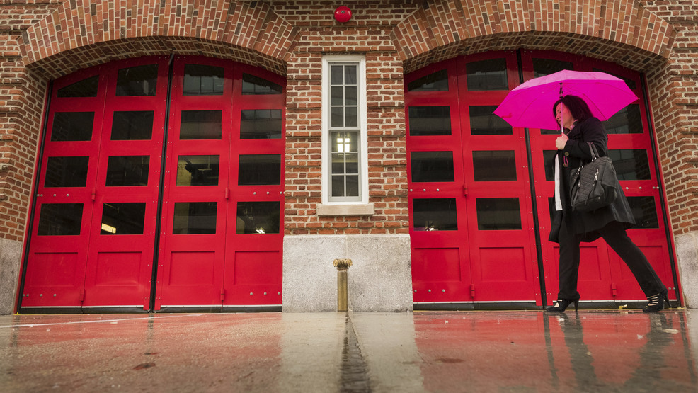 A Pedestrian Is Framed In The Red Doors Of A Fire Station During A Rain  Storm In Washington, Thursday, May 17, 2018. Rain Is Expected To Continue  In The ...
