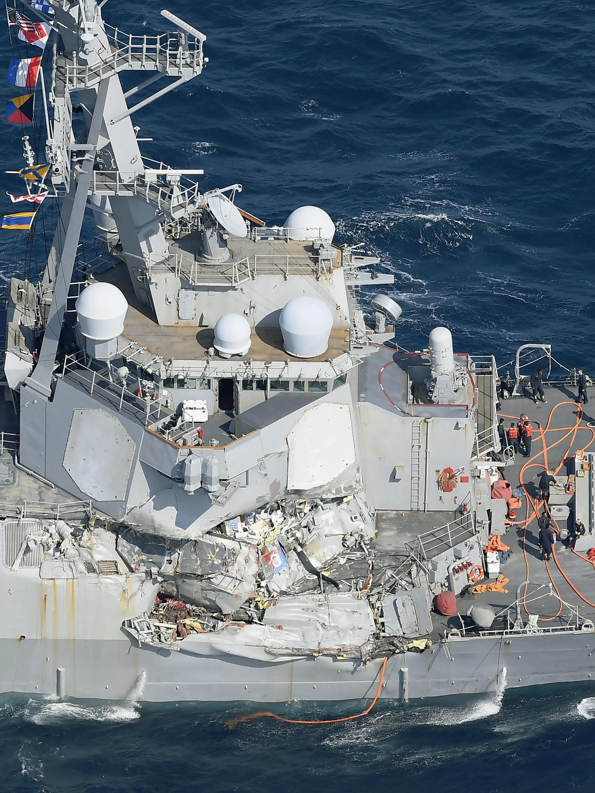 CORRECTS DATE  - The damage of the right side of the USS Fitzgerald is seen off Shimoda, Shizuoka prefecture, Japan, after the Navy destroyer collided with a merchant ship, Saturday, June 17, 2017.  The U.S. Navy says the USS Fitzgerald suffered damage below the water line on its starboard side after it collided with a Philippine-flagged merchant ship.  (Iori Sagisawa/Kyodo News via AP)