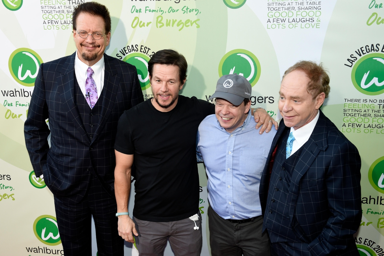 Penn Jillette, Mark Wahlberg, Paul Wahlberg and Teller pose for photos as they arrive at a VIP event at Wahlburgers Las Vegas in the Grand Bazaar Shops at Bally's Tuesday, March 28, 2017. [Sam Morris/Las Vegas News Bureau]