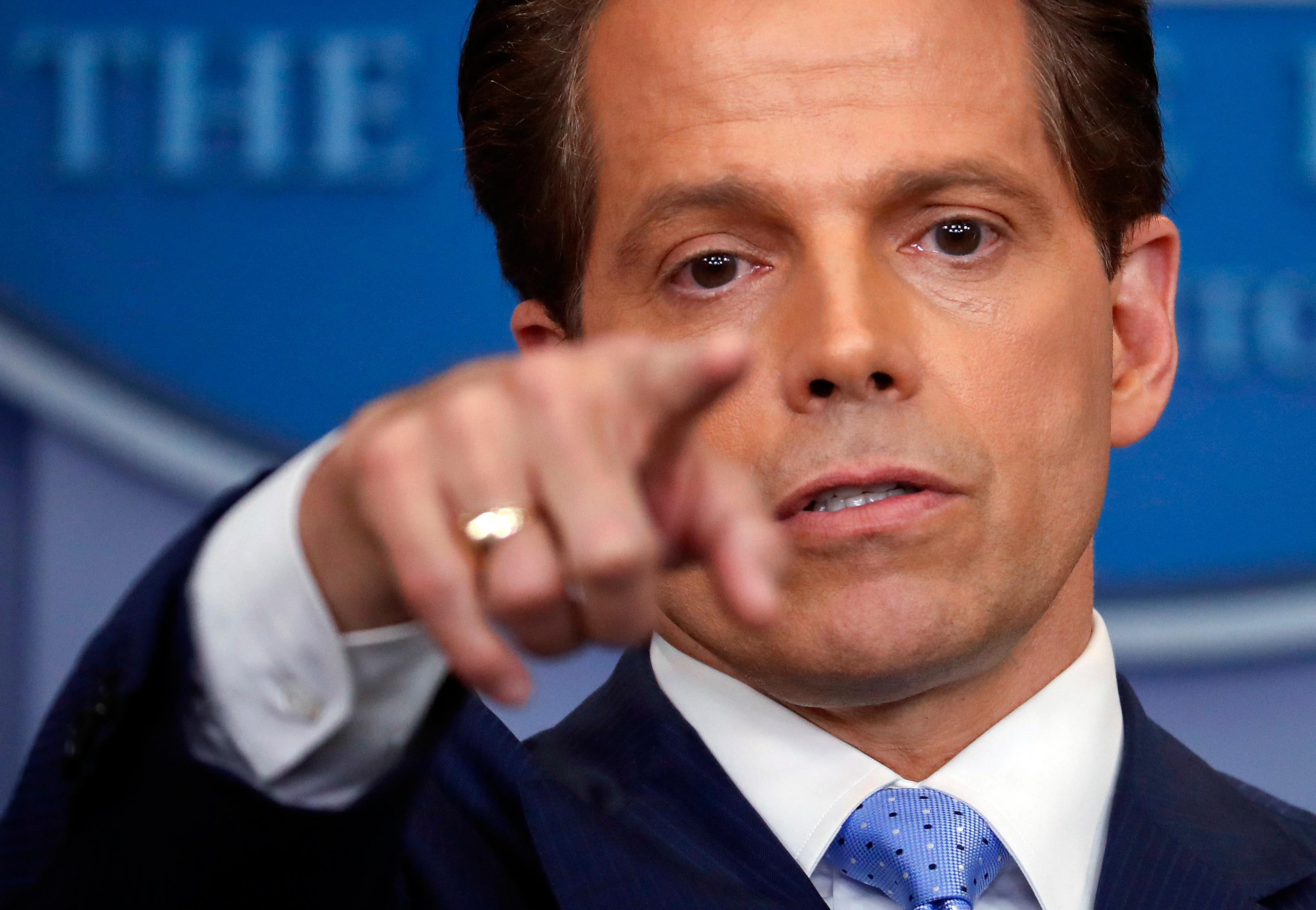 In this July 21, 2017 photo, incoming White House communications director Anthony Scaramucci points as he answers questions from members of the media during the press briefing in the Brady Press Briefing room of the White House in Washington.  Scaramucci is out as White House communications director after just 11 days on the job.  A person close to Scaramucci confirmed the staffing change just hours after President Donald Trump's new chief of staff, John Kelly, was sworn into office.  (AP Photo/Pablo Martinez Monsivais)