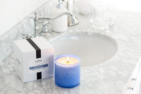 Scented candles with relaxing natural scents, like lavender and sandalwood, relax and renew guests. Try adding them to the powder room to provide a respite from a bustling party.{ }(Image: Courtesy Marla  Beck)
