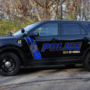 Officer disciplined after teen's police car suicide