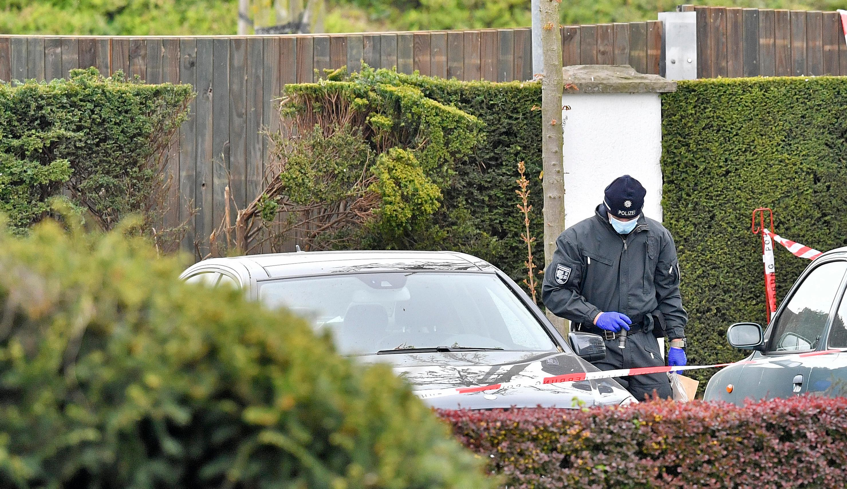 FILE - In this April 12, 2017 file photo police investigators search for evidence at the hedge near the team hotel of Bundesliga soccer club Borussia Dortmund in Dortmund, Germany, the day after the team bus was damaged in an explosion which injured a player and a police officer. (AP Photo/Martin Meissner, file)