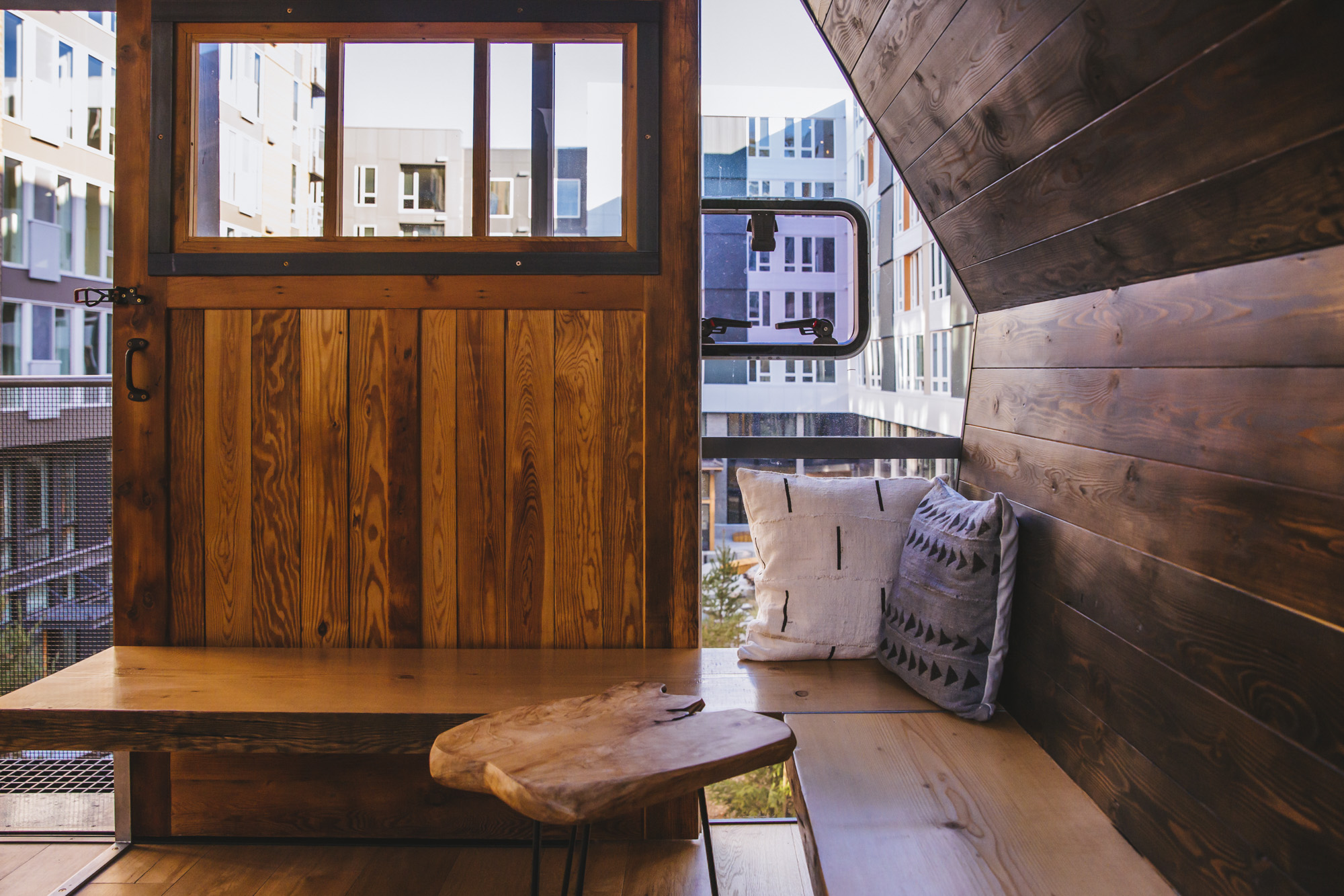 Have you ever wished for a grown-up treehouse? If so (and you have the dough) you're in luck. Sitka Apartments in South Lake Union just completed an urban treehouse, available to the residents on a first-come, first-served basis. The treehouse has a green roof, skybridge, fireplace, seating, pond, benches, decks, courtyard and small cooking area. Apartments at Sitka, managed by Vulcan Real Estate, start at $2,020. There are also 77{ }multi-family tax exemption units available to{ }people earning 65 to 80 percent of average median income. (Image: Sunita Martini / Seattle Refined)